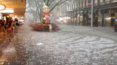 Hail covers Queen Street Mall outside Myer. (Polly Banks)