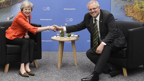 Mr Morrison and Mrs May shook hands after they met for face-to-face talks