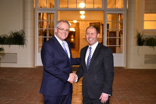 Prime Minister Scott Morrison and Deputy Liberal leader Josh Frydenberg after a swearing in ceremony at Government House in Canberra.