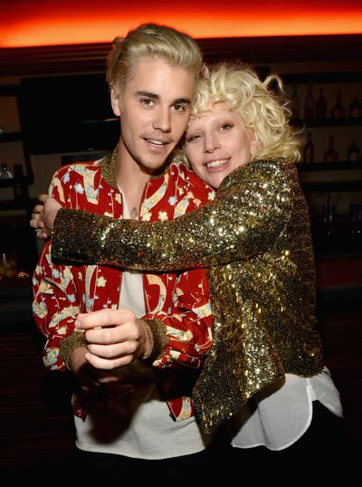 Justin Bieber hugging Lady Gaga and Pamela Anderson wearing clothes  aren't things you'd ever expect to see, let alone at a fashion show, but Saint Laurent's runway at Hollywood's Palladium attracted a front row like no other. Click through to see what happens when music and fashion collide.