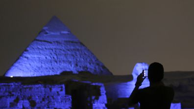 <p>To mark the 70th anniversary of the founding of the United Nations, landmarks across 60 countries were bathed in blue light yesterday, the official colour of the organisation.</p><p>Egypt lit up the Giza pyramids for the event. (AAP)</p><p><strong>Click through to see some of the globe's most famous monuments lit up.</strong></p>