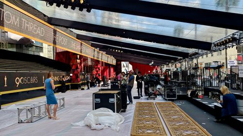 Crews are still working to assembly the red carpet set. (9NEWS/Ehsan Knopf)