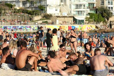 Beachgoers are seen at Bondi Beach despite the threat of Coronavirus (COVID-19) in Sydney, Friday, March 20, 2020.