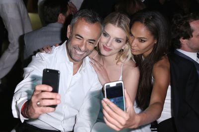 <p>Calvin Klein's Francisco Costa, Lily Donaldson and Joan Smalls</p>
