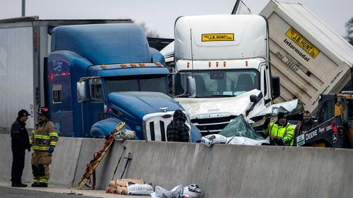 At least five people were killed when up to 100 vehicles were caught in a pile-up during a wintry storm in Fort Worth, Texas.