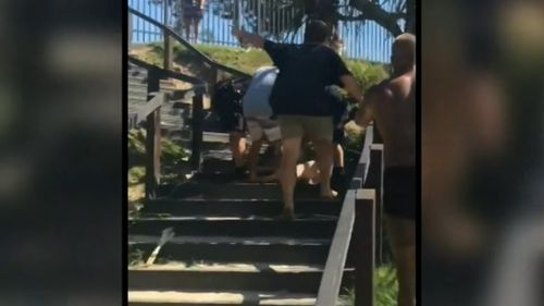 The woman appears to be knocked unconscious during the scuffle. (Facebook)