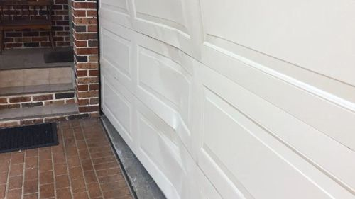 The door was damaged by the impact.