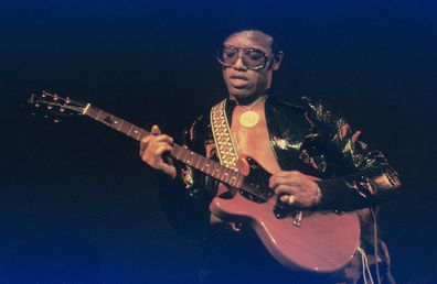 Bobby Womack performs on stage in 1976 in Amsterdam, Netherlands. He plays a left-handed Gibson Les Paul Junior guitar.