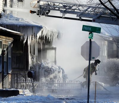 Firefighters at the scene of a house fire in St Paul, Minnesota.