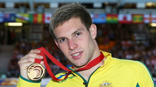 Gold medallist Daniel Fox during the medal ceremony, after his victory in the men's para-sport 200m freestyle in Glasgow.