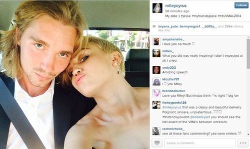 Miley Cyrus poses with her date to the MTV Video Music Awards. (Instagram)