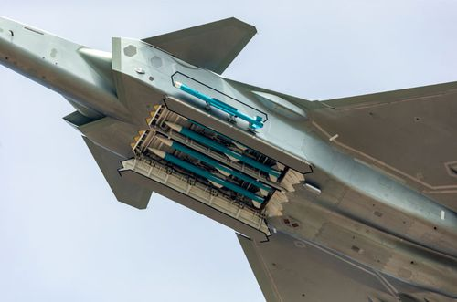 The J-20 opened its weapons bay to show four long-range missiles.