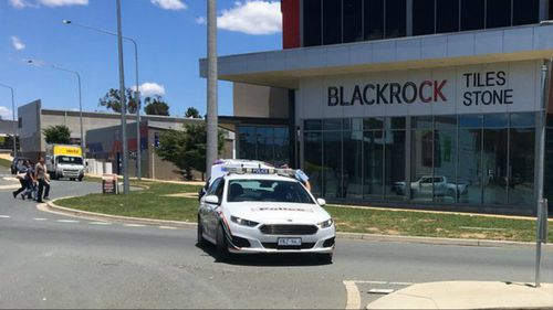 Police siege at Canberra business 'resolved'
