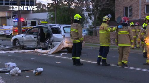 Police are now searching for three other occupants of the car who fled the crash. (9NEWS)
