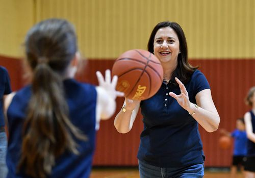 Queensland Premier Annastacia Palaszczuk is seen playing basketball with members of the Wizards Basketball club at the Brisbane Entertainment Centre. (AAP)