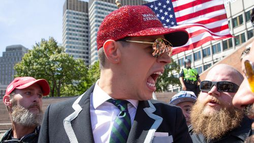 Right-wing commentator Milo Yiannopoulos was the parade's grand marshal.