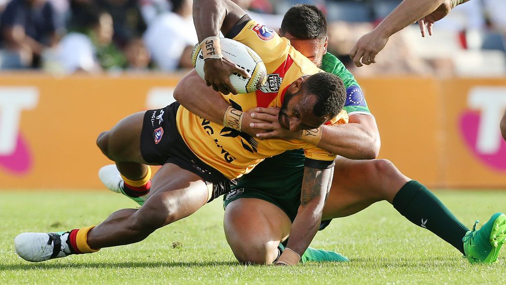 Kumuls player Stargroth Armean in action Cook Islands. (AAP)