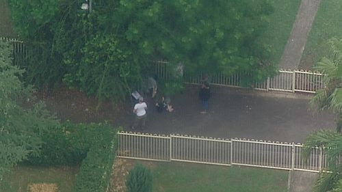 Three people including a child were bitten by dogs in Sydney's west.