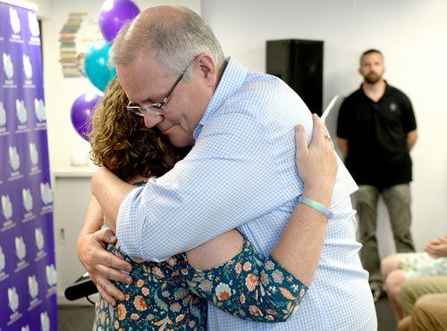 Scott Morrison hugs Fiona Ryan.