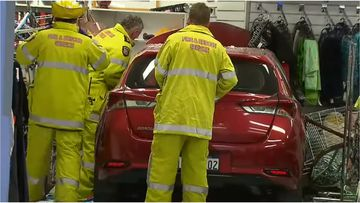Three people have been hospitalised after an elderly driver crashed into a Salvation Army shopfront in Craigie.