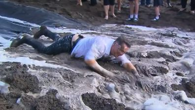Karl Stefanovic completes muddy slip and slide into cow dung
