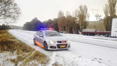 A police car on the Hume Highway in Breadalbane (between Goulburn and Gunning) yesterday. Police there issued a warning for drivers to take care in the icy conditions.