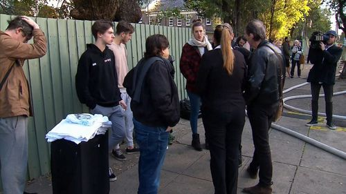 There are 12 homes within the block, with residents forced onto the streets when the fire sparked at 5.50am. (9NEWS)