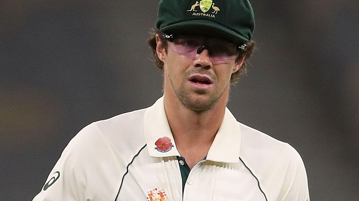 Travis Head of Australia is seen wearing low light glasses while fielding