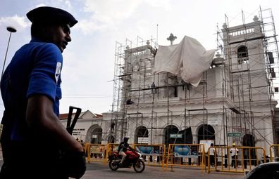 A military officer patrols outside the bombed St Anthony's Church, currently under reconstruction in Colombo, Sri Lanka.