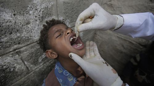 A Yemeni boy receives a cholera vaccination during a house-to-house immunization campaign in Sanaa, Yemen.