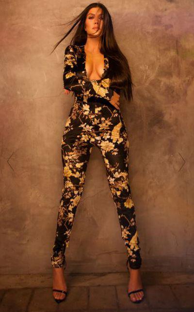 """<a href=""""https://www.prettylittlething.com.au/black-floral-velvet-jumpsuit.html"""" target=""""_blank"""">Black floral velvet jumpsuit, $60.</a>"""