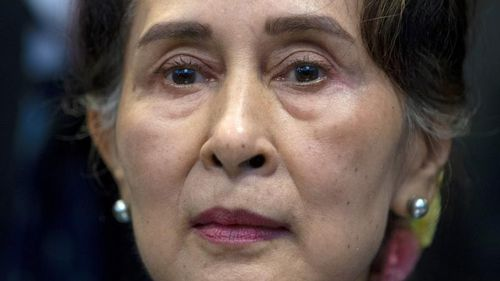 Myanmar puts Suu Kyi on trial on charges critics call bogus