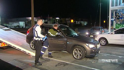 The alleged offenders dumped a stolen car in a McDonalds carpark. (9NEWS)