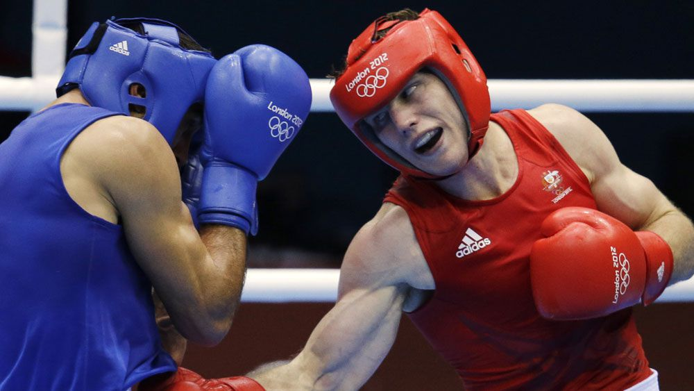 Abderrazak of Tunisia, left, and Jeffrey Horn of Australia, fight during the men's light welterweight boxing competition at the 2012 Summer Olympics. (AAP)