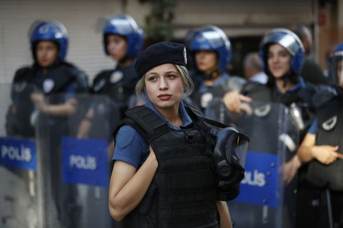 Turkish police prepare to disperse activists on a street in central Istanbul, after a Pride march event was banned by authorities.