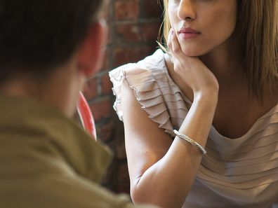 Woman looking bored on date