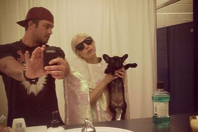 "Gaga and boyfriend Taylor Kinney are completely besotted with their new ""batpig"" puppy Asia. We can see why!"