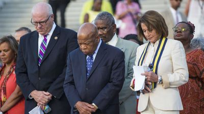 US Democratic Congressmen Joseph Crowley of New York (L) and John Lewis of Georgia (C), along with House Minority Leader from California Nancy Pelosi (R) hold a moment of silence for the victims. (AFP)