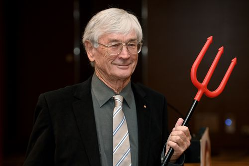 Dick Smith reprises the Grim Reaper AIDS advert at his press conference today.