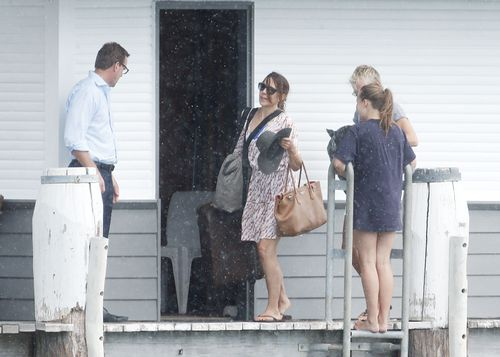 The Royals pause for a family chat before seeking shelter. Picture: Matrix News