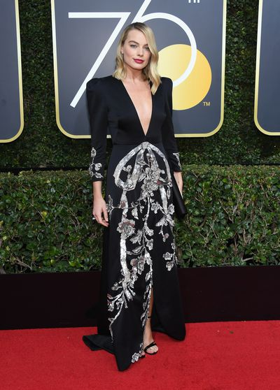 """<p>The red carpet is looking dark, at least as far as the clothing is concerned.&nbsp;<br /> <br /> In solidarity with&nbsp;Hollywood&rsquo;s anti-sexual harassment movement,&nbsp;now officially named Time&rsquo;s Up, the plan in the lead-up to the awards show has been for actresses to wear black to stand together in unity and send a very clear message. And in a move that saw women fist-pumping from their couches around the world, wear black they have.&nbsp;<br /> <br /> Actress Eva Longoria said this year&rsquo;s Golden Globes was not a """"fashion moment but a moment of solidarity"""". And while that may be true, the stars have made sure of something with their fashion choice and that that black certainly doesn&rsquo;t have to mean boring.</p> <p>Take it away&nbsp;Margot Robbie in Roger Vivier and&nbsp;Tiffany &amp; Co. jewels&nbsp;</p> <div>&nbsp;</div>"""