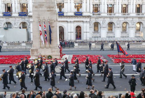 Some of the 10,000 British veterans who marched through London streets after the ceremony.