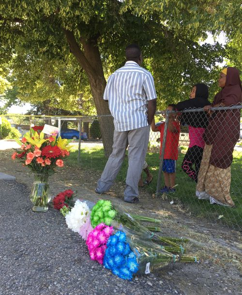 Floral tributes have been laid out front of the apartment complex where the children were attacked. Picture: AP