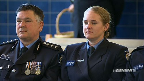 Police and SES volunteers stood alongside Ian's family and friends to say goodbye. Picture: 9NEWS