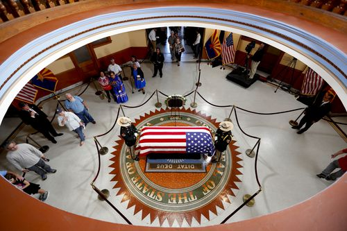 The casket lies in state in Arizona - following the commemorations of Senator Marilyn Jarrett and athlete Jesse Owens.