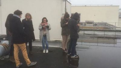 "The journalists pictured in this dramatic photo are taking shelter on the roof of a Paris building during the armed assault on the nearby headquarters of Charlie Hebdo. <br><br> Martin Boudot tweeted this shot of his colleagues with the caption, translated from French: ""Attack by two hooded men on the offices of Charlie Hebdo. We've taken refuge on the roof"".<br><br>  The tweet was later deleted but not before being shared thousands of times."