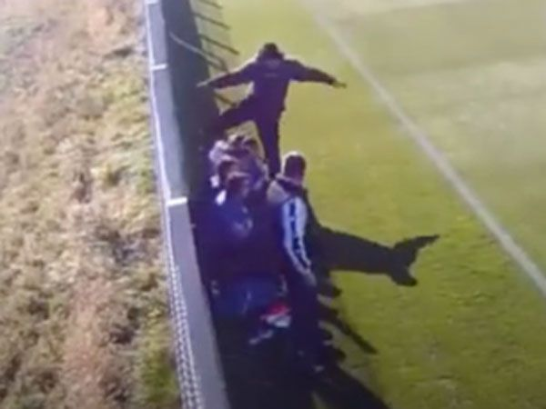 Football coach filmed kicking youth player