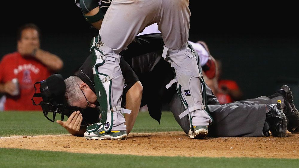 Baseball: Umpire felled by flying bat in MLB