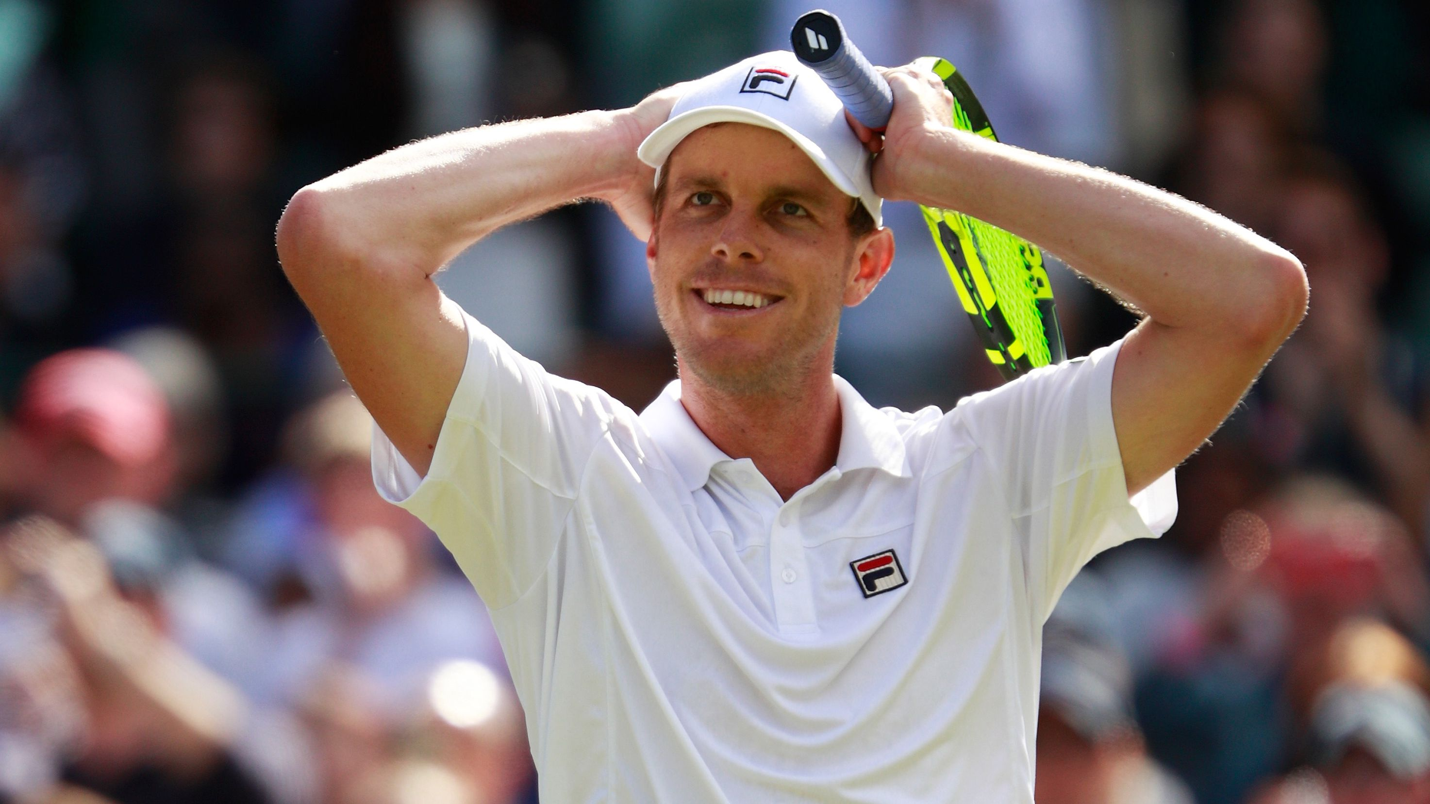 Sam Querrey reacts during a match at Wimbledon.