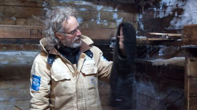 Mawson's Huts Foundation conservator Ian Godfrey with a balaclava found in the building.